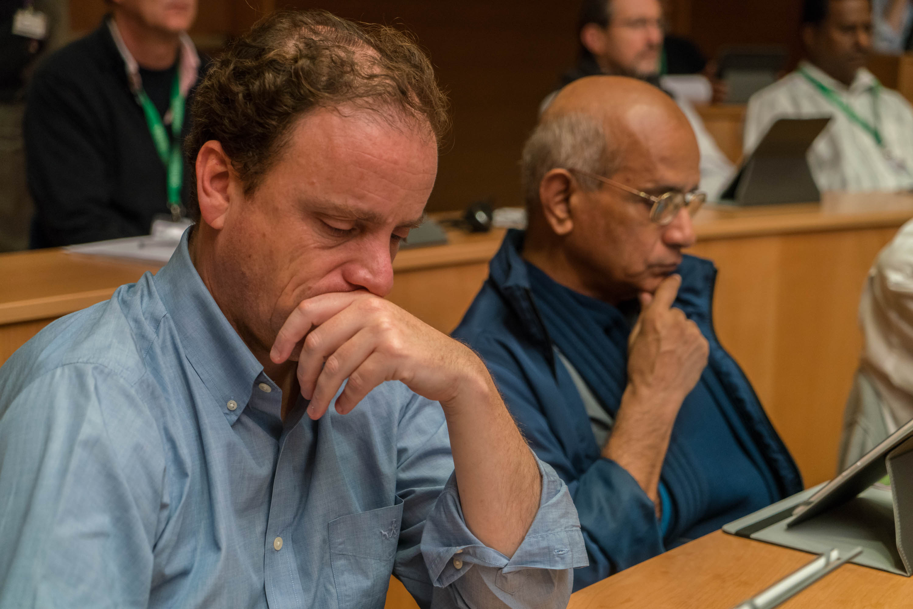 Two Jesuits look over meeting materials in the aula, or meeting room, Oct. 20 at General Congregation 36. The global meeting of Jesuits will make governing decisions for the next several years. Photo credit: Courtesy of General Congregation 36