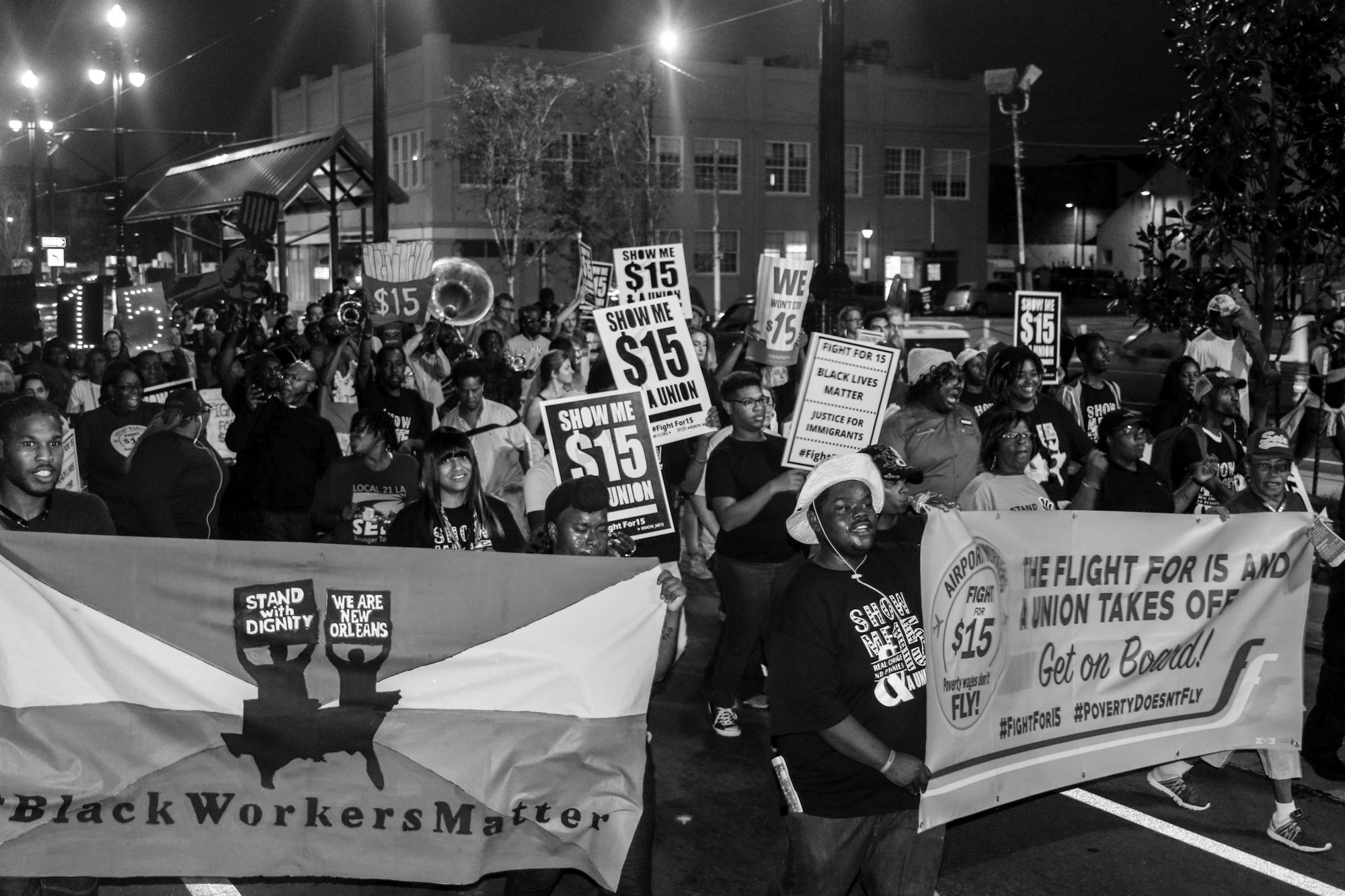 Members of the FightForFifteen activist group march to raise the federal minimum wage to $15 per hour. Many of the Founding Fathers of the United States wrote extensively about the need for a politically engaged populace. Photo credit: Matthew Dietrich