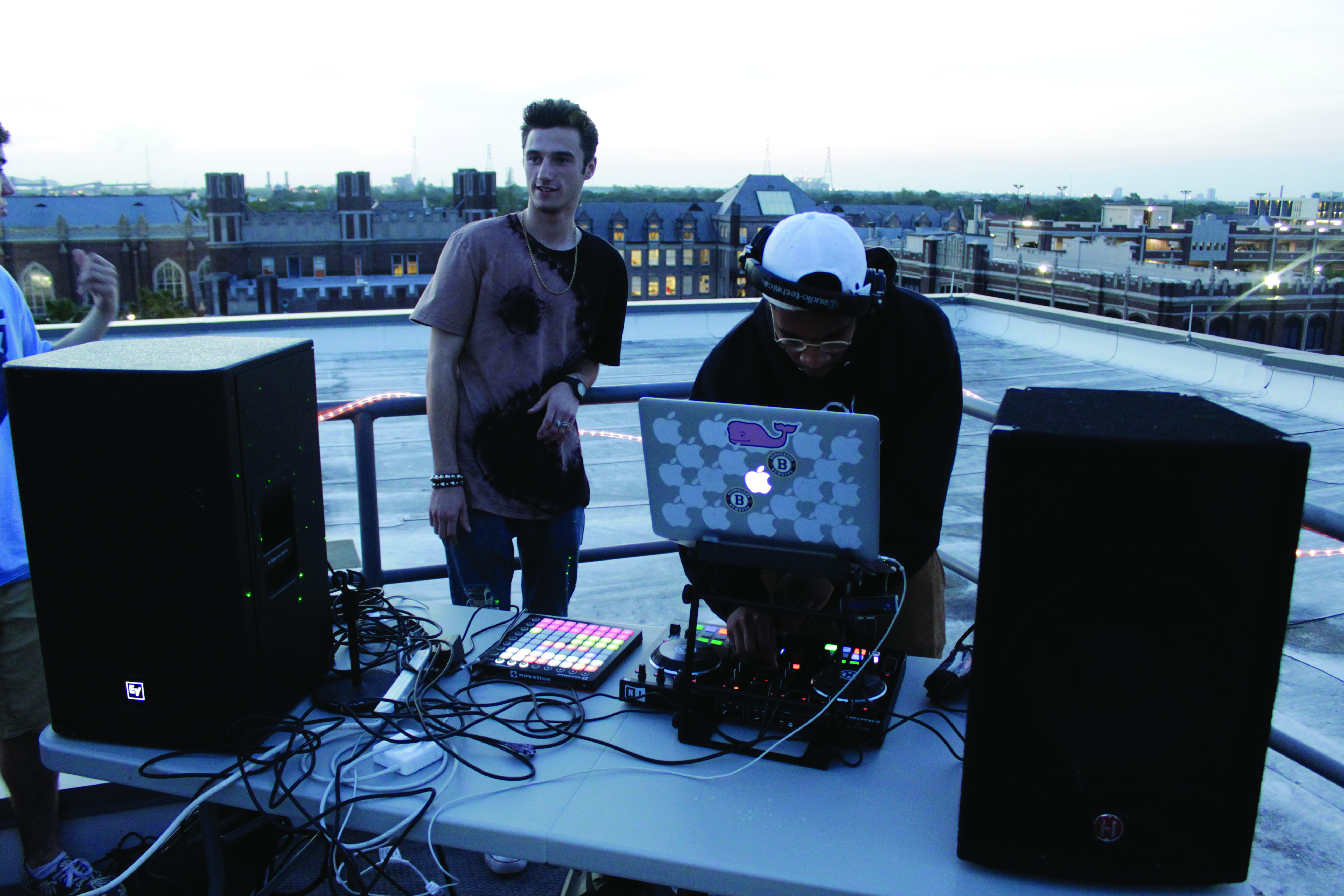 Rapper Skylar Allen (left) listens to DJ Derek Taylor (right) run the music for the Earth Day event. Taylor's DJ set followed a live performance from Tristin and Jana Sanders. Photo credit: John Casey