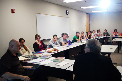 Professors John Clark (left foreground) and John Biguenet (right foreground) lead a discussion on the hardships of life in New Orleans during and after Katrina in their daily class session June 8.