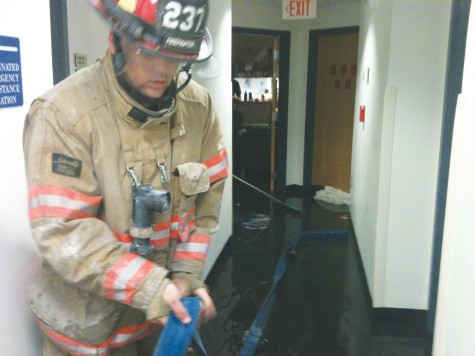 Burst fire sprinkler floods Carrollton Hall