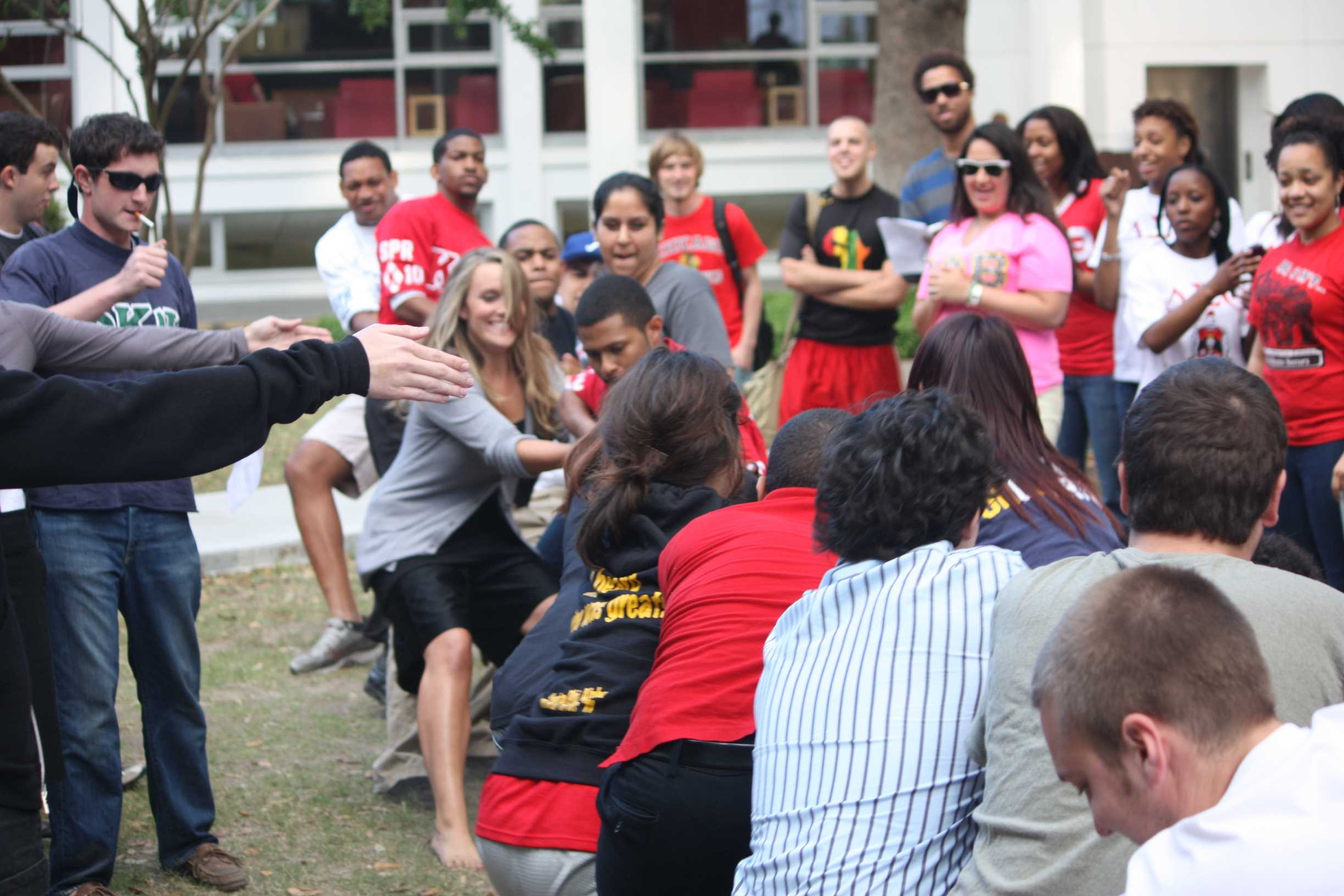 Members of all Loyola fraternities and sororities partcipate in a tug of war at this year's Greek Week. Greek Weeks ends with field day events.