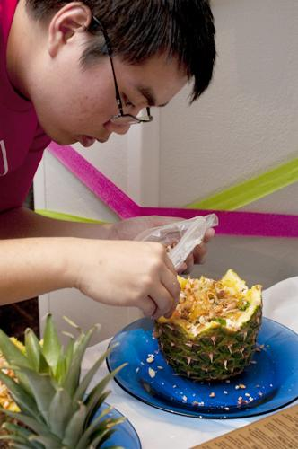 Johnathan Lam, biology freshman,  puts some finishing touches on a pineapple dish.  Loyola Asian Student Organization hosted the 2011 Iron Chef competition in the St. Charles Room on April 12.