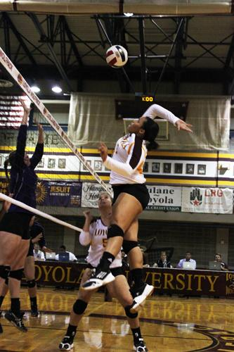 Chemistry and history sophomore Sabrina Stansberry jumps for a return during Loyola's first home game against Millsaps College on Tuesday, Sept. 12 in the Den.