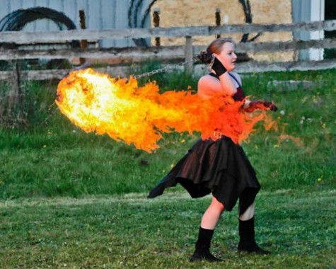 Student performs with fire