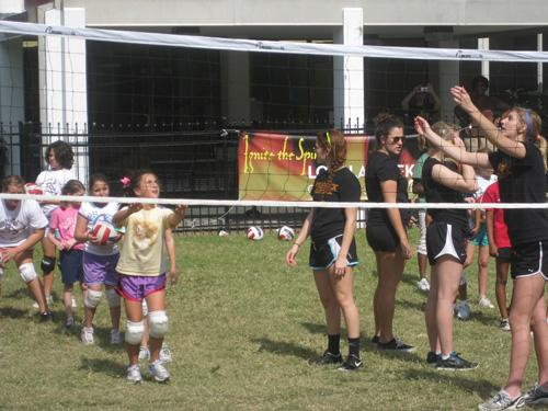 Members of the women's volleyball team spend the day with local Girl Scouts in the Residential Quad on Sunday. Oct 23.