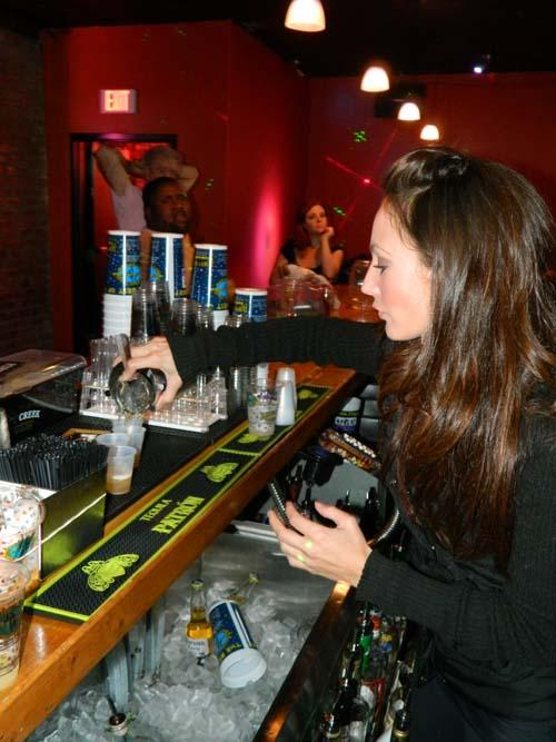 A+bartender+pours+a+drink+at+Krazy+Korner.+Krazy+Korner+offers+interesting+music+and+drink+specials.+