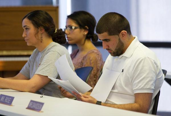 New SGA president Khaled Badr, right, looks over a proposal brought before the student government at the weekly SGA meeting Wednesday, April 25.