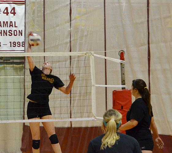 Psychology pre-med junior Libby Collyer spikes the ball to her teammates during a volley practice. The women's volleyball team started the season 8-0 and is practicing to stay strong in the game.