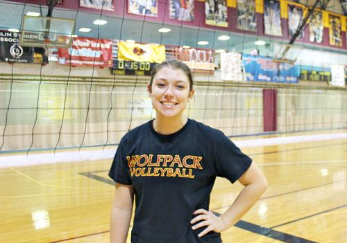 Environmental science sophomore Becca Burnett poses for a photo after practice. Burnett has moved to the libero position for this season.