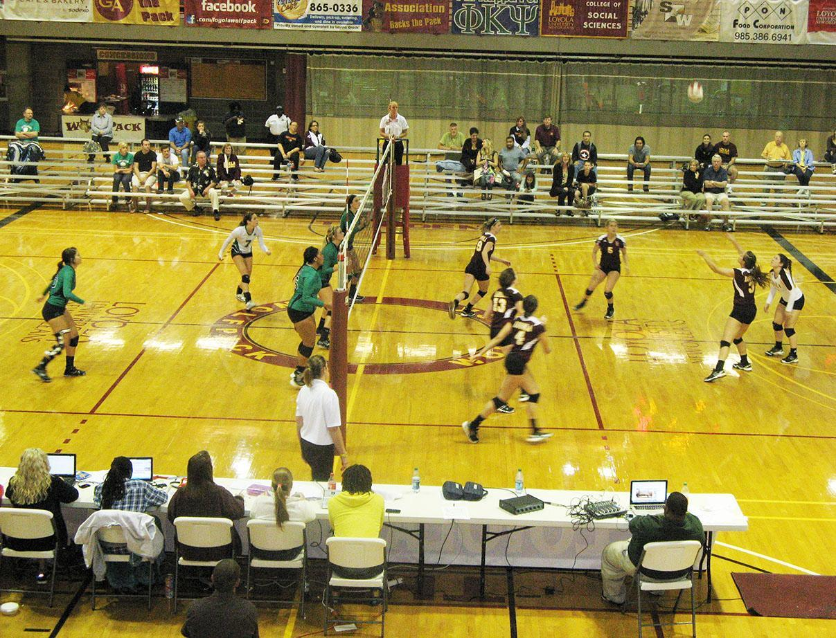 The Loyola Wolf Pack receives a serve from University of Arkansas Monticello during the Loyola-hosted Hampton Inn Invitational. The Pack defeated Arkansas Monticello in straight sets and went undefeated in the tournament.