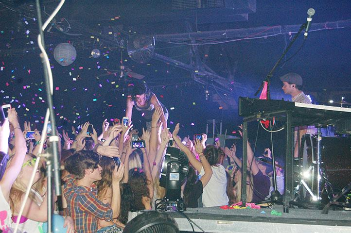 Kim Schifino, of Matt & Kim, crowdsurfs over a group of concert attendees during Loup Garou at the Howlin' Wolf. Loup Garou is an annual spring concert put on by the University Progamming Board.