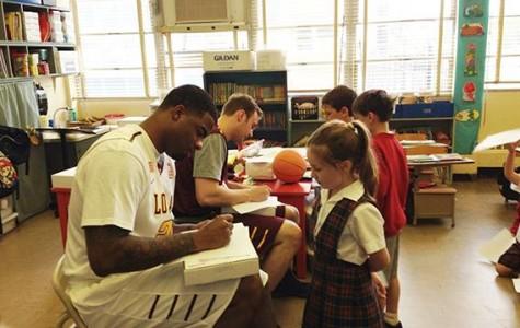 Basketball players teach elementary kids