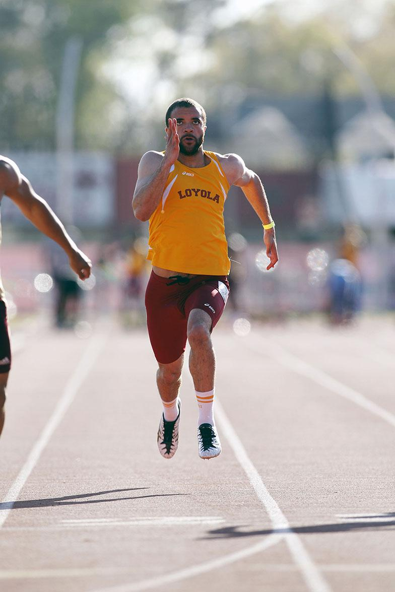 """Managment senior Claude """"Mookie"""" Nelson sprints down the track. Nelson decided to try out for Loyola's track team his freshman year."""