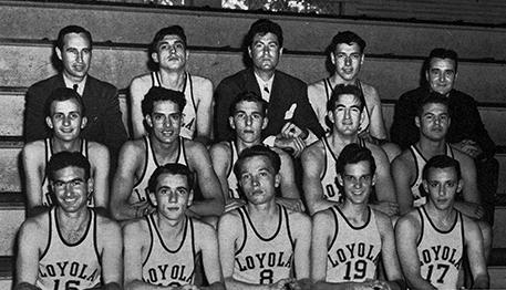 Players and coaches of the 1945 Loyola men's basketball team pose for a photograph on the bleachers of the old basketball court. The team went on to bring home a national basketball championship amidst the surrounding events of World War II.