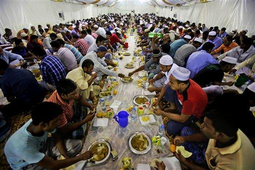 Muslims in Dubai, United Arab Emirates gather for the final days of Iftar dinner for the celebration of Eid. Ramadan requires Muslims to fast from eating, drinking and smoking from sunrise to sunset.