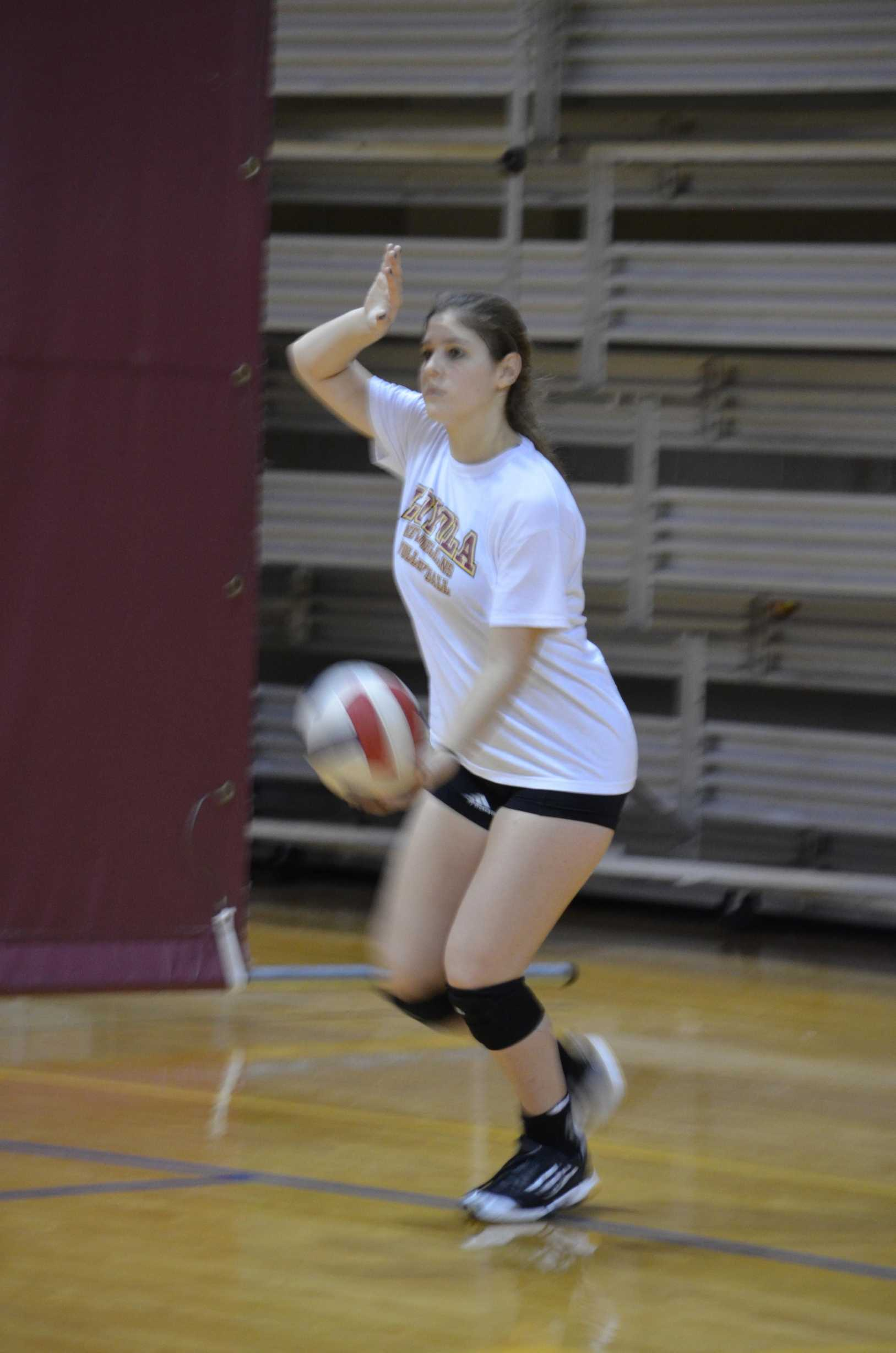 Daniela Leal prepares to serve the ball at a recent practice at the Rec plex. Leal  was offered a roster spot by first year head coach Margot Fredrick .