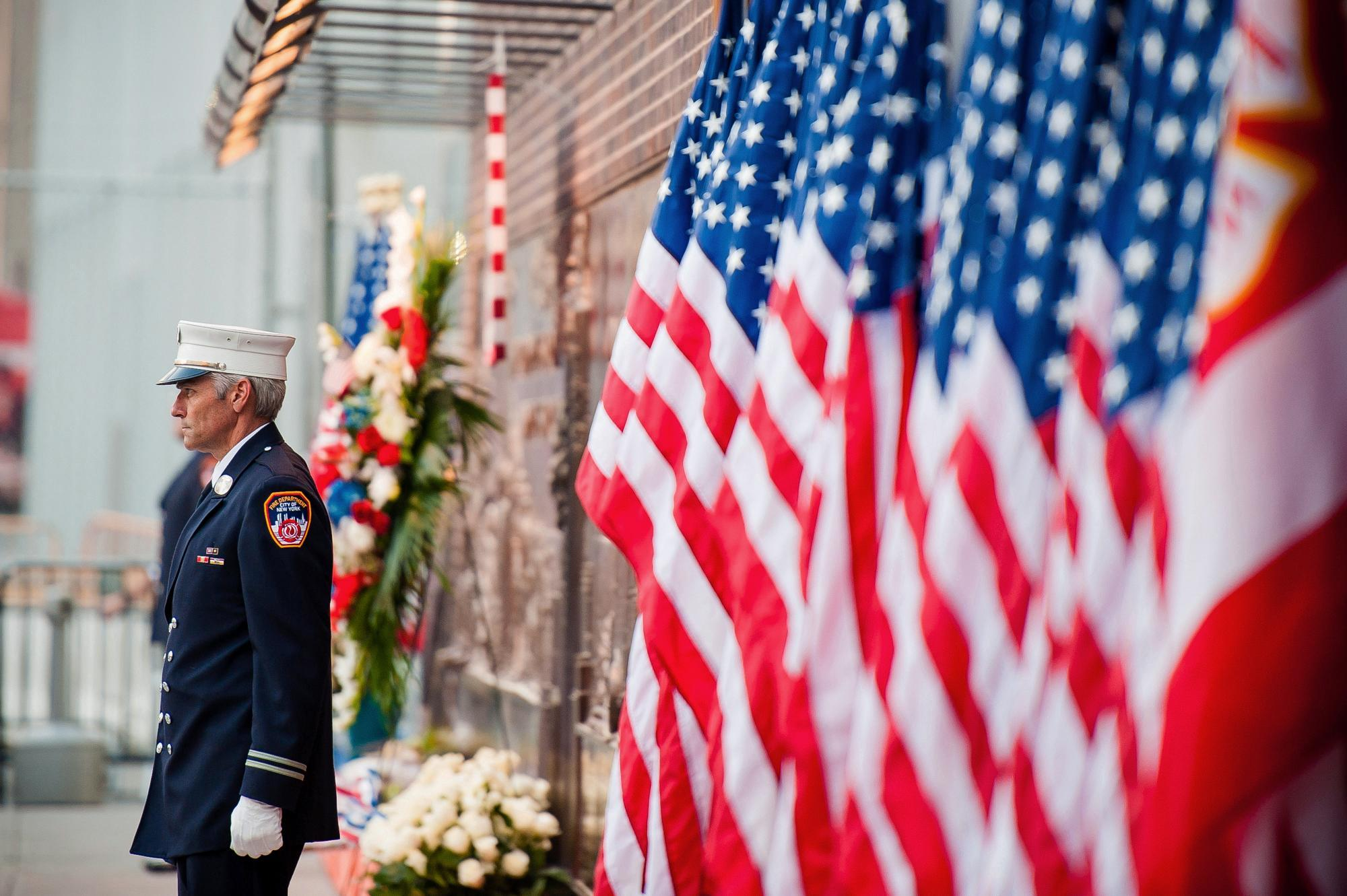 A firefighter stands near the entrance of the 9/11 Memorial in New York. Memorials were held across the U.S. for those killed in the 9/11 terrorist attacks