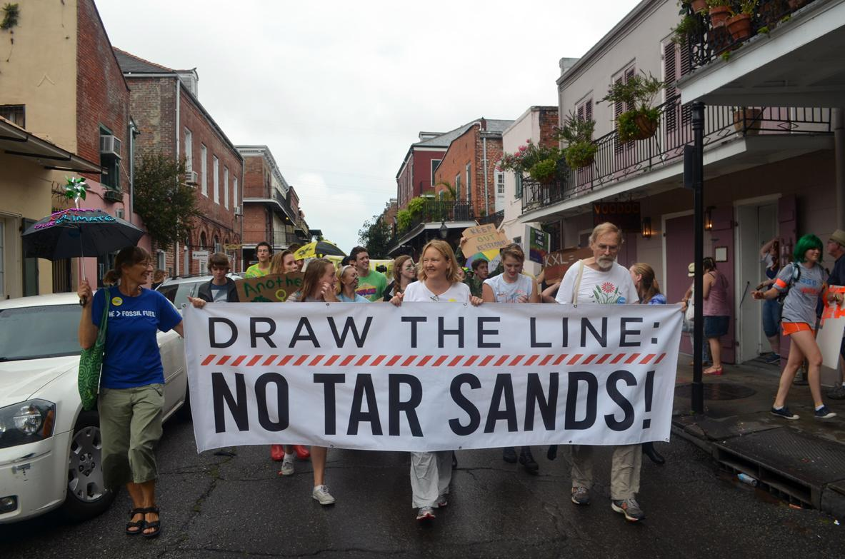 Protesters march through the French Quarter in opposition of the proposed Keystone XL Pipeline expansion. Over 200 people participated in the second line-style protests.