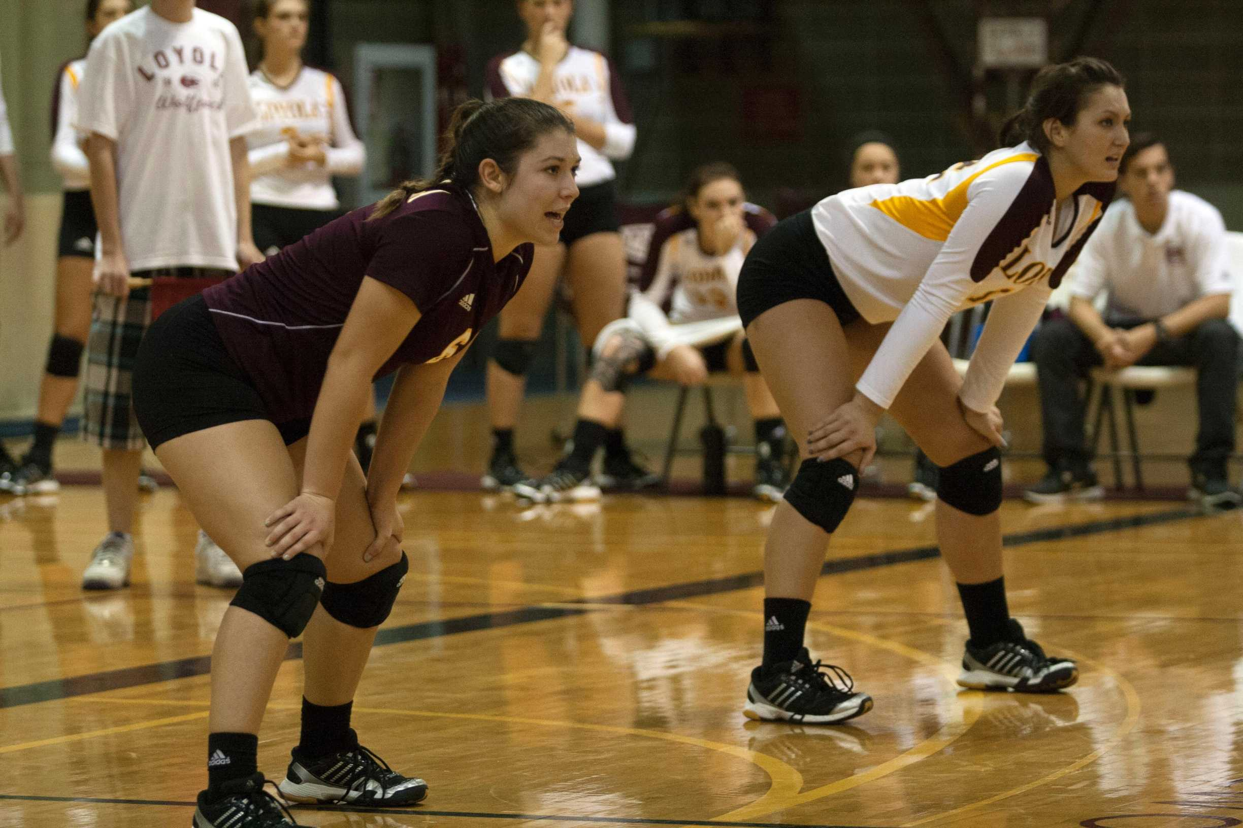 (Left to right) Environmental business junior and libero Becca Burnett and general studies business sophomore and outside hitter Katie Hamilton prepare to defend a serve in a game against Spring Hill College last season. Loyola lost to Spring Hill in straight sets in this season's match up.