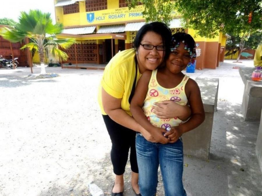 Heather+Malveaux%2C+director+of+Immersion+Programs+for+University+Ministry%2C+hugs+a+Jamaican+student+from+Holy+Rosary+Primary+School.+In+Jamaica%2C+Ignacio+Volunteers+cared+for+the+destitute+and+dying+and+helped+teach+in+primary+schools.+