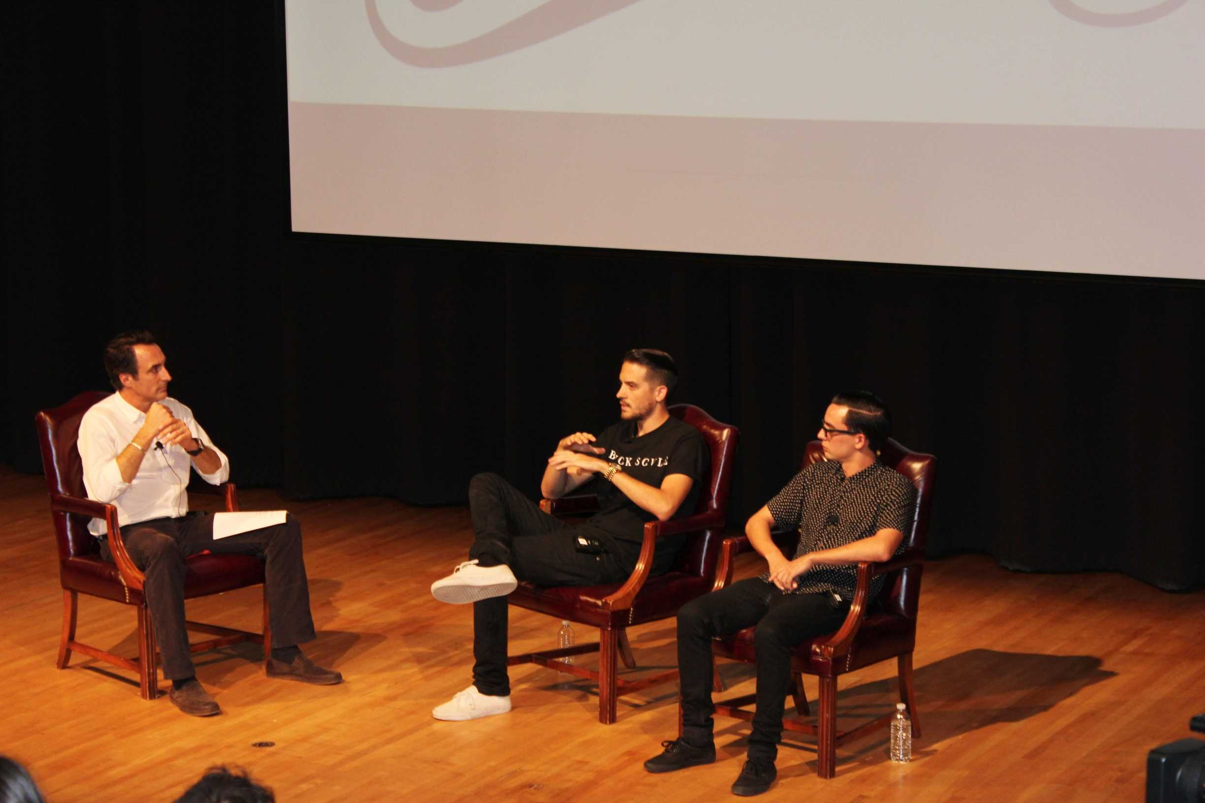 Gerald Gillum (left), A'11, and Matt Bauerschmidt (right), A'10, talk to a room of Loyola music industry students. On Sept. 16 in Nunemaker Hall, the pair spoke as a part of the music industry program's weekly forum.