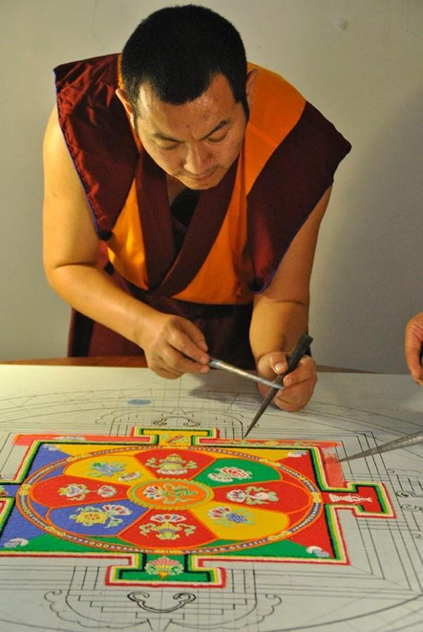 Tadin+Tsewang%2C+a+Tibetan+Buddhist+monk%2C+creates+a+sand+mandala+in+the+Danna+Student+Center+using+long+and+narrow+ridged+funnels%2C+called+chakpurs%2C+to+lay+down+colored+marble+grains+on+Tuesday%2C+Nov.+11.+On+Thursday%2C+Nov.+14%2C+six+Buddhist+monks+distributed+sand+from+the+mandala%2C+as+a+blessing+to+Loyola+students+for+their+contributions.+
