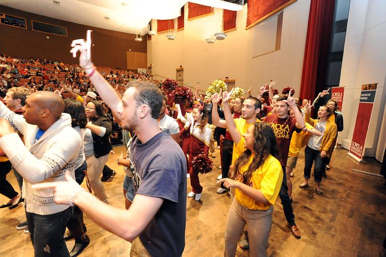 Students+from+different+organizations+dance+to+the+Loyola+song+in+Roussel+Hall.+Fall+Open+House+was+a+recruiting+event+to+allow+prospective+students+to+visit+campus+that+happened+on+Saturday%2C+Nov.+16.