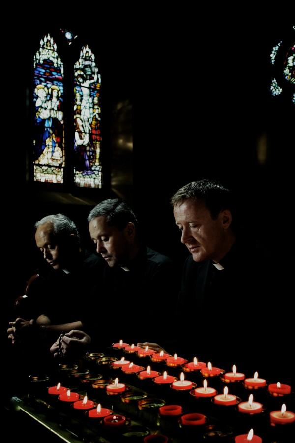 The+Priests+kneel+in+prayer.+The+Irish+music+group%2C+which+has+performed+around+the+world%2C+sang+at+Loyola+on+November+26.