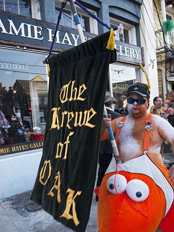 Nemo carries the Krewe of O.A.K. banner.