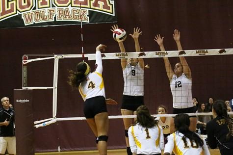 Eva Allen, a mass communications junior, blocks the ball against