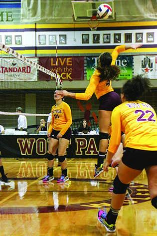 Eva Allen, a mass communication junior, volleys the ball back ag
