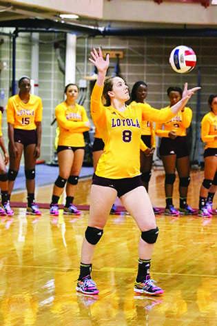 Lauren Brand, a psychology senior, serves the ball against Bethe