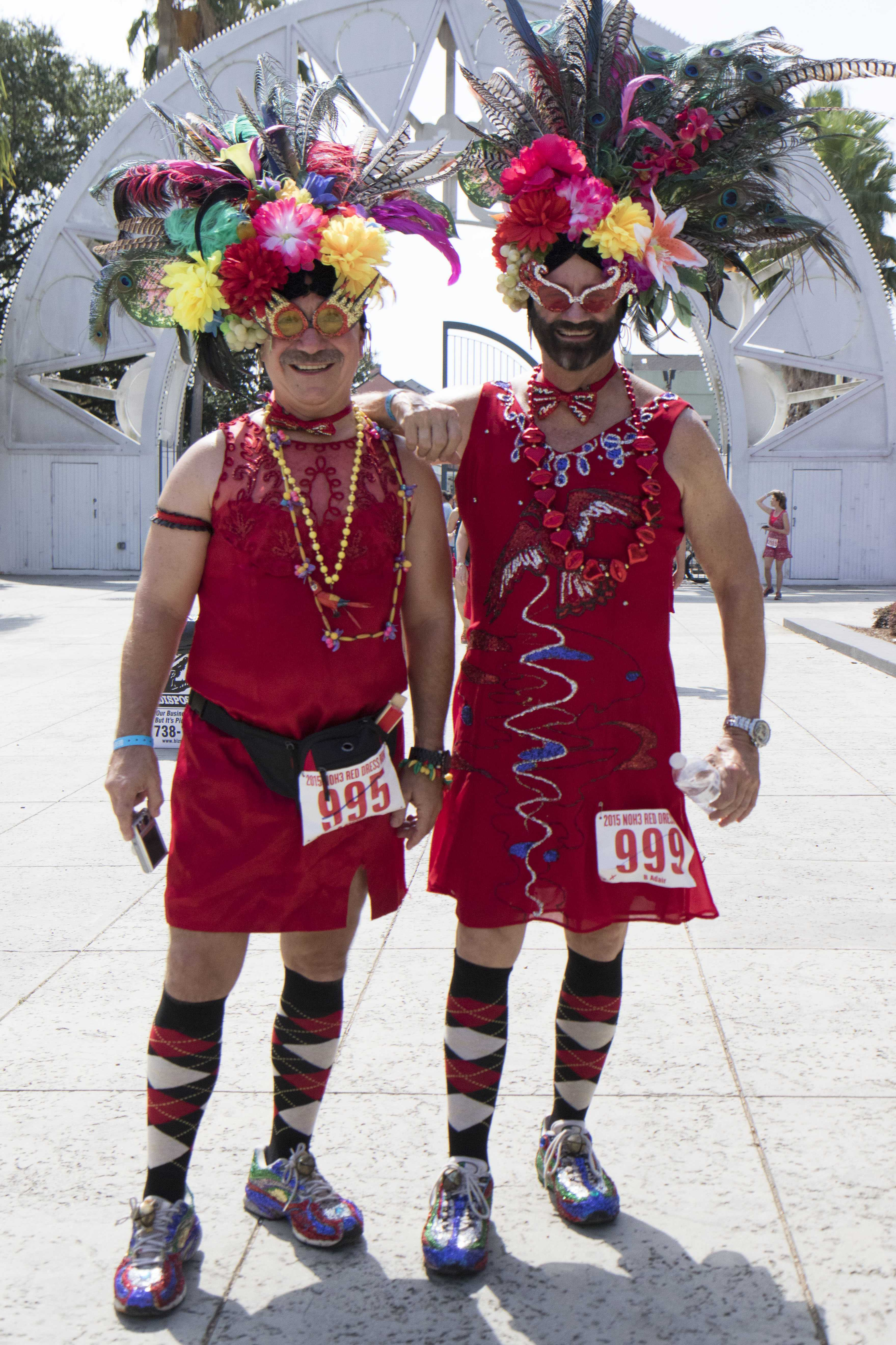 Rick Rheauxme, left, and Bill Adair, right, arrive in red in Armstrong Park for the annual Red Dress Run. The annual event, which takes place in the French Quarter, raises over a million dollars for over 100 charities in the greater New Orleans area. Photo credit: Zach Brien