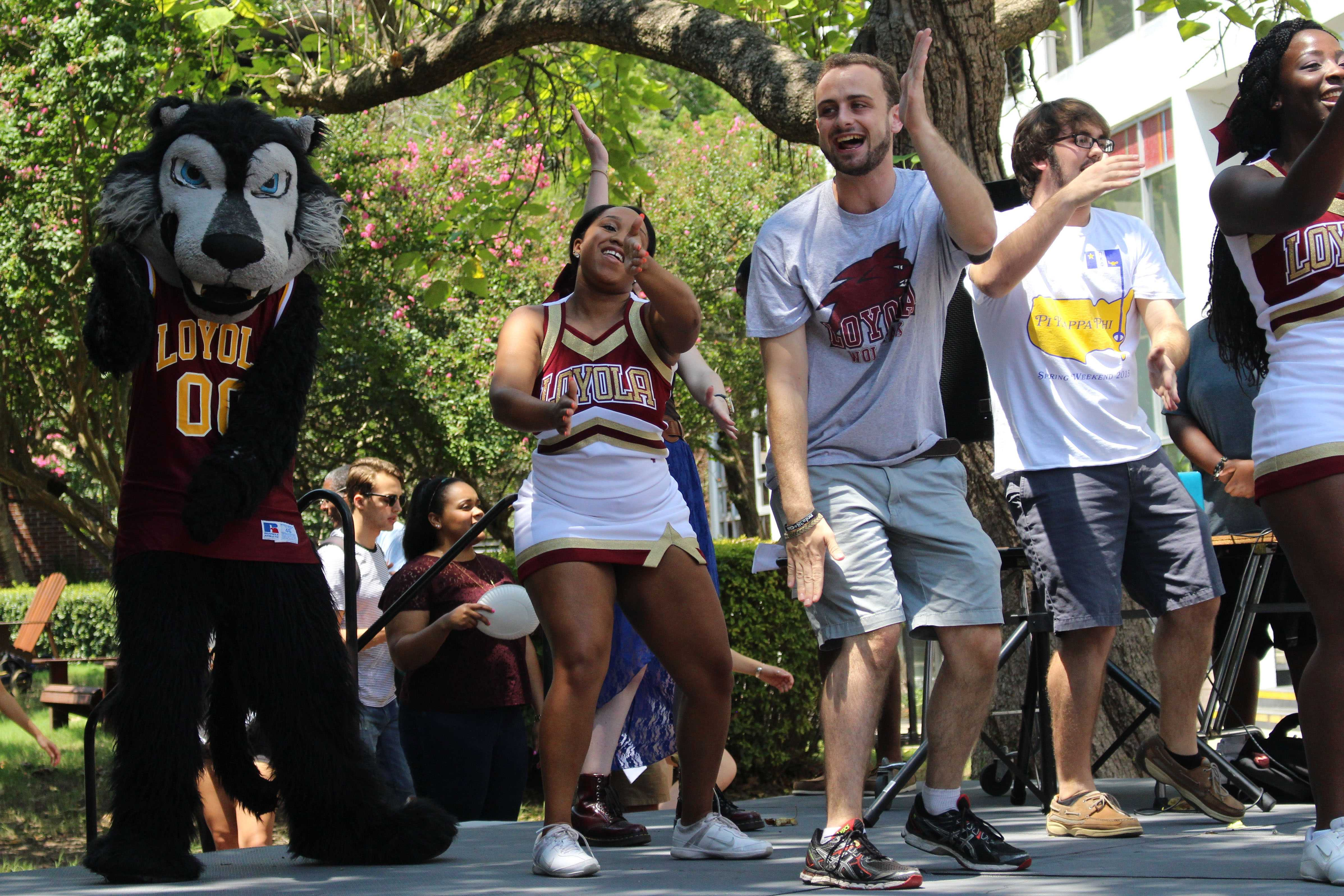 Loyola's mascot, Havoc, joined SGA president Nate Ryther, an economics senior, and other students in a dance at the Back to School Rally on Tuesday in the Peace Quad. The event featured complimentary food, music, dancing and a presentation of the school's newest athletes. Photo credit: Kristen Stewart