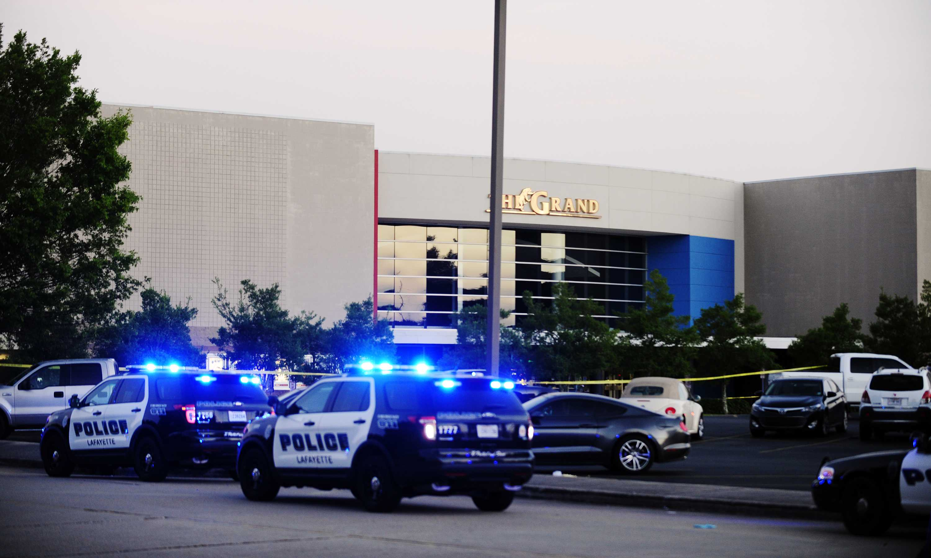 Law enforcement and other emergency personnel respond to the scene of a shooting at the Grand 16 movie theater on Thursday, July 23, 2015, in Lafayette, La.