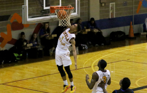 Women and Men's Basketball claim first conference victory