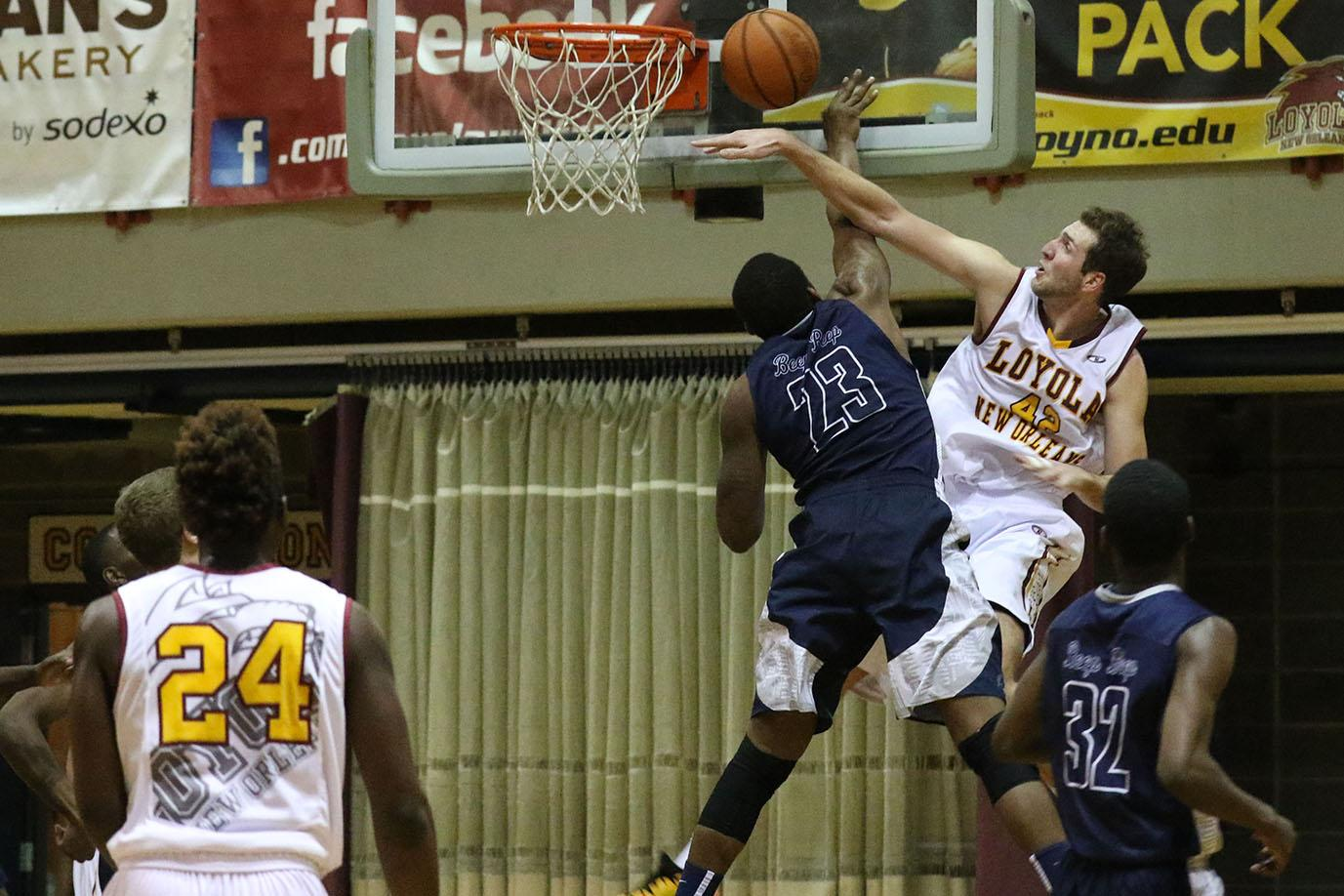 Marcel Hawkins, Dalton State junior forward, blocks a dunk attempt by Nate Pierre, Loyola junior center, in the second half of their game in The Den on Jan 2, 2016. Loyola fell to SSAC rival Dalton State 70-67 despite outscoring them in the second half 37-35.