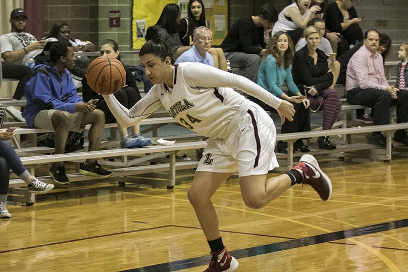 Loyola junior guard Caroline Gonzalez lunges for a loose ball in a game against Blue Mountain College in the Den. The women won 95-57.