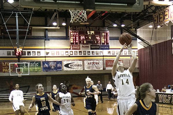 Loyola freshman guard Menley Long makes a layup on a fast break against Blue Mountain College in the Den. The women won 95-57.