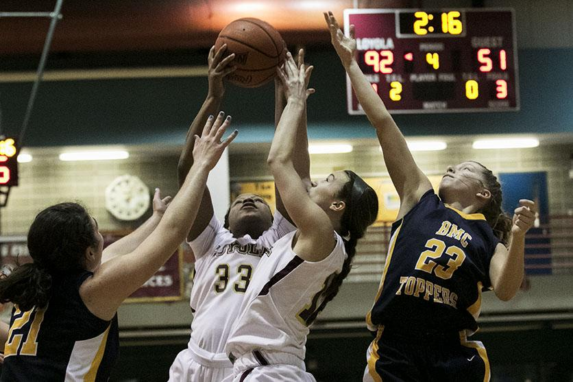 Loyola freshman forward Nyree Grant pulls in a rebound at the end of the fourth quarter in a game against Blue Mountain College in the Den. The women won 95-57.