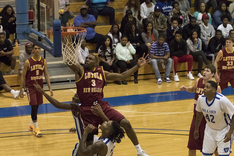 Johnny Griffin Jr., Loyola junior guard, puts back a missed shot by guard Tre'Von Jasmine in the first half of their game at Dillard University. Griffin finished with 10 points in a 93-80 loss to Dillard.