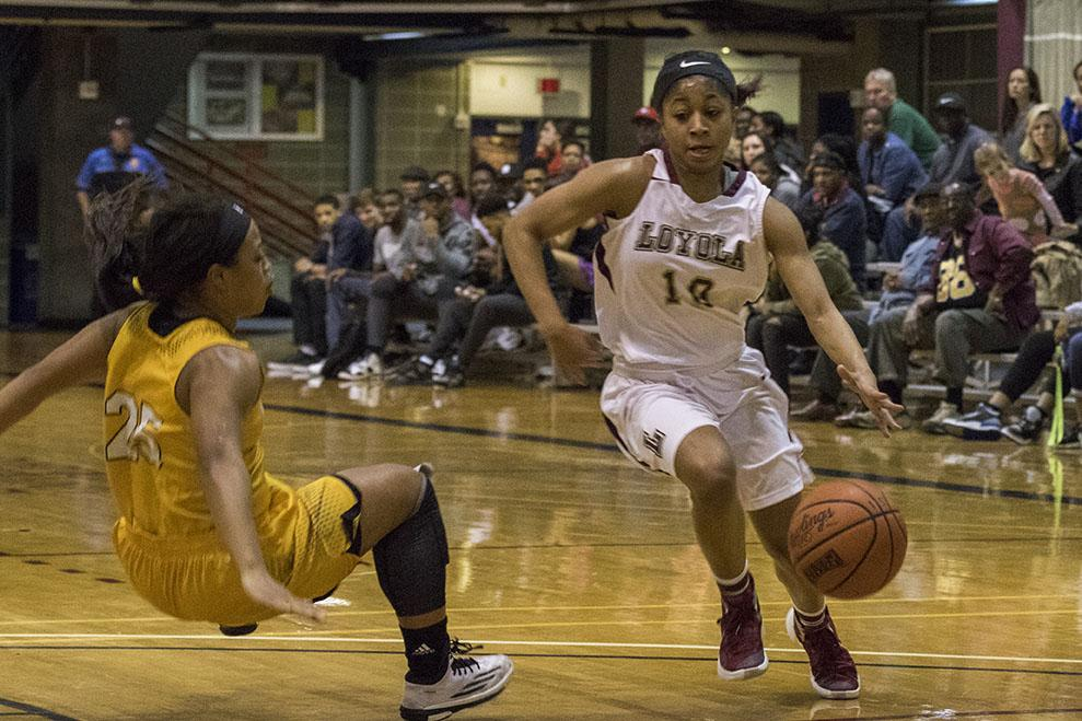 Zoie Miller, Loyola sophomore guard, blows past Whitney Gathright, Xavier senior guard, in the second quarter of their game in the Den. The women defeated Xavier University 67-57 in their final home game of the 2016 season.