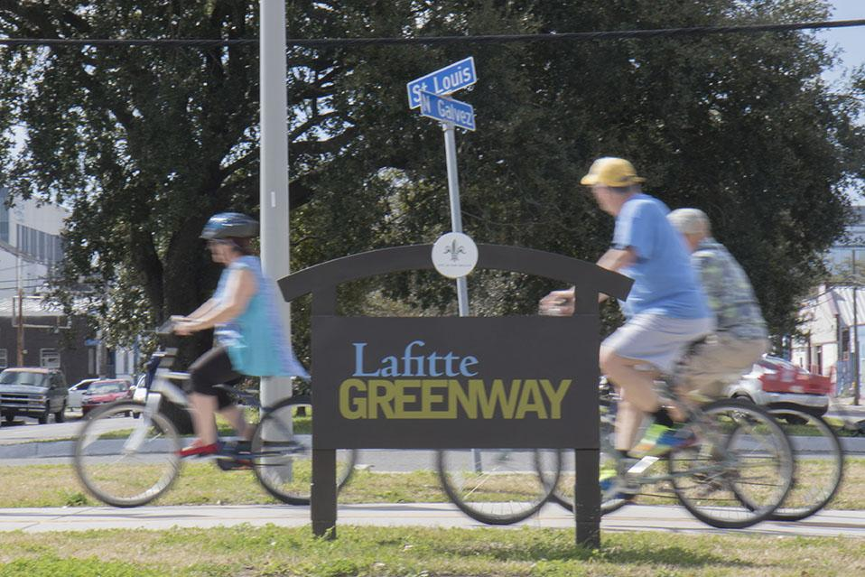 Cyclists cross N. Galvez along the Lafitte Greenway in the Treme neighborhood. The greenway, which is the future site of Fit Lot, allows people to bike from Mid City, through Treme and to downtown.