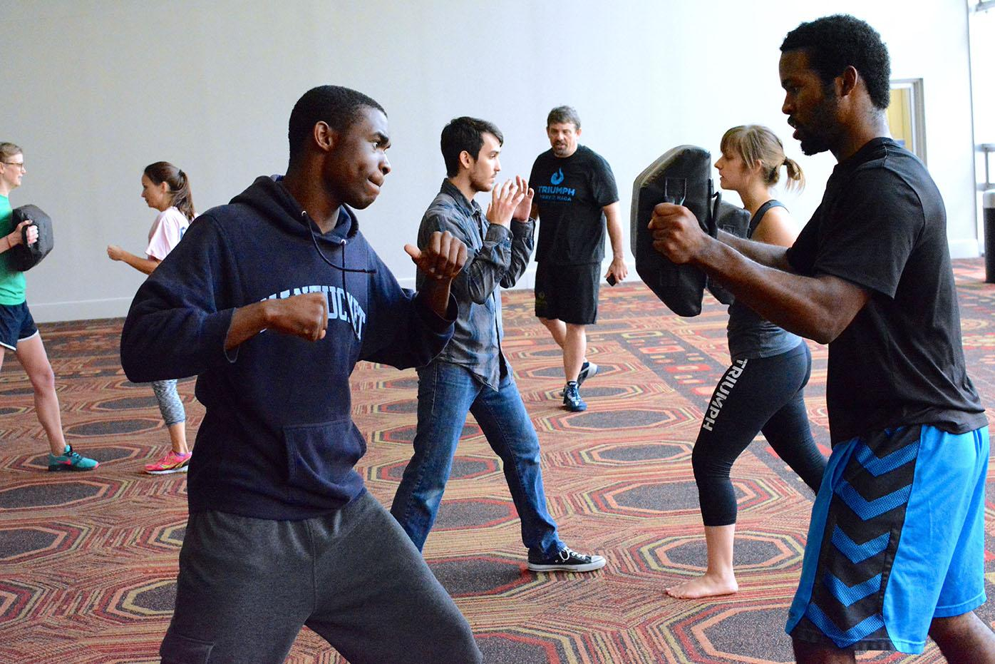 Raymond Price, mass communication junior, practices Krav Maga in the Danna Center. The Get Fit Pledge is a movement to help students get in shape and will last all semester.