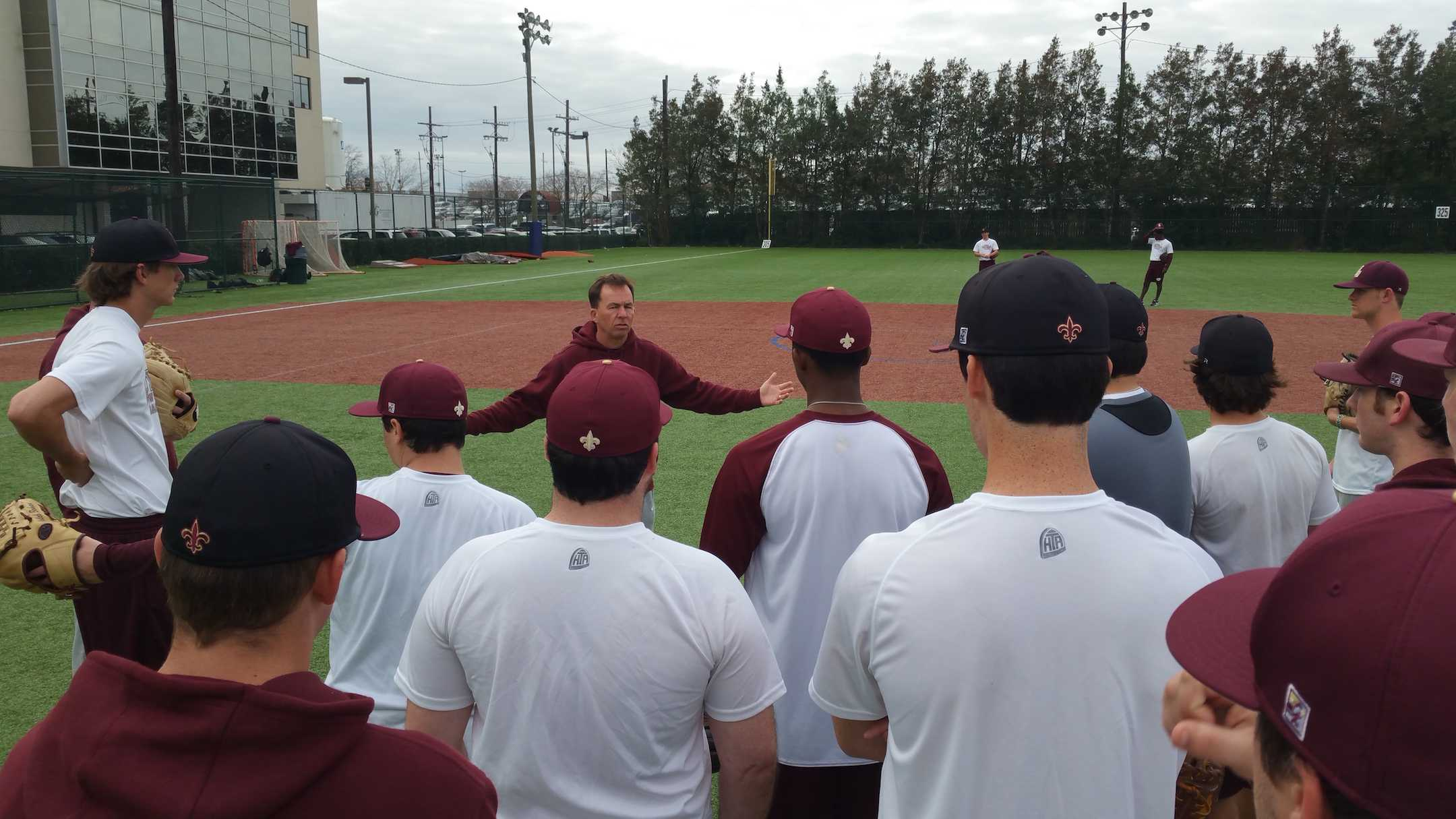 Doug Faust, head coach, addresses the Loyola baseball team at a team practice at Segnette Field. The baseball team has a record of 18-25 on the season and plays their next game in Mobile, Alabama against the University of Mobile on April 15 at 6 p.m.