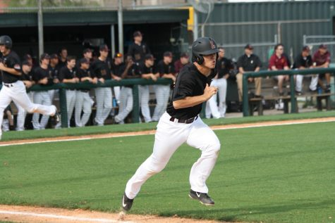 Sophomore Spencer Rosenbohm sprints to first base after hitting a single against William Carey on Friday, April 29.