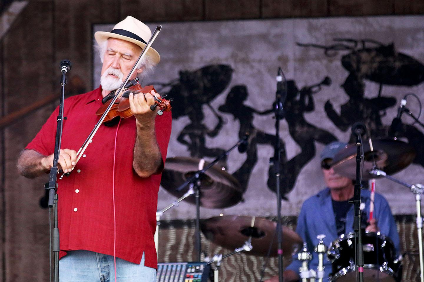 Michael Doucet plays his violin at the Fais Do-Do stage at the 2015 New Orleans Jazz and Heritage Festival.