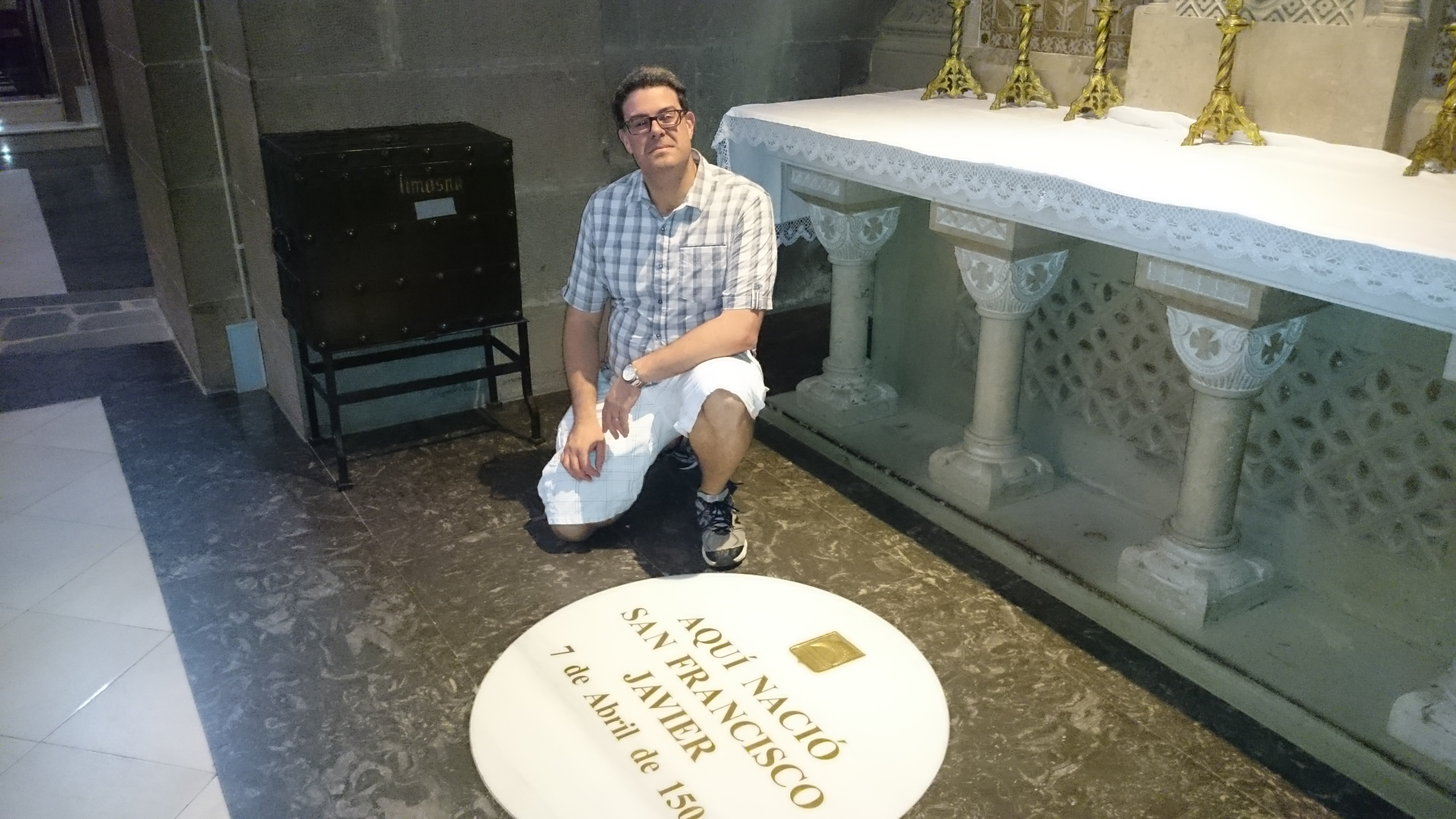 John Sebastian, vice president for Mission and Ministry, kneels next to the birthplace of St. Francis Xavier. Sebastian visited important sites from Ignatius' life this summer. Photo credit: Courtesy of John Sebastian