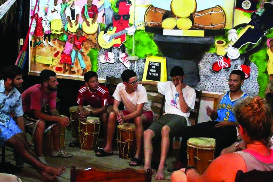Loyola+students+and+alumni+teach+drumming+at+a+music+program+they+established+in+Belize.+The+Belize+trip+was+established+because+there+were+previously+no+university+programs+for+music+in+the+country.+Photo+credit%3A+Courtesy+of+the+Rev.+Ted+Dzak+S.J.